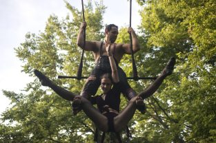 Sam Sion and Sylvia Friedman sharpen their trapeze act in the backyard of their Riverside home on July 16. (Alex Rogals/Staff Photographer)
