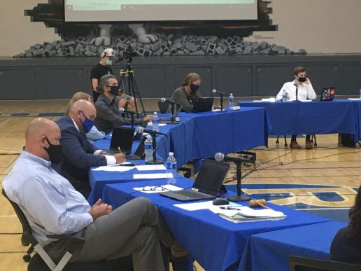 Members of the RBHS school board and administration listen to public comments during the Aug. 11 District 208 school board meeting in the gymnasium of the high school. | Bob Skolnik/Contributor