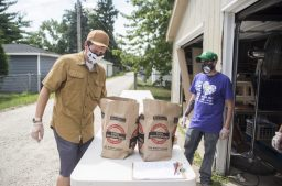 Volunteers Greg Martin, left, of LaGrange, and John Kobylarz, of Lyons, prepare groceries for clients to pick up curbside on Aug. 15, 2020, at the Share Food Share Love Food Pantry in Brookfield. (Alex Rogals/Staff Photographer)
