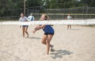 Lauren Mantel bumps a pass to a teammate during a pickup game of volleyball on a steamy, 95-degree day on Aug. 24 at the sand courts at Kiwanis Park in Brookfield. (Alex Rogals/Staff Photographer)