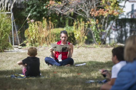 Students socially distance outside while listening to a book being read on Sept. 2, at A.F. Ames Elementary School in Riverside. (Alex Rogals/Staff Photographer)