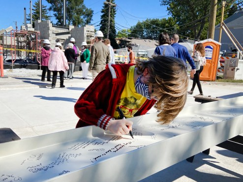 Among those signing steel I-beams to be installed on the second floor of the new library was Brookfield resident Linus Starr, who visits the existing library weekly and is looking forward to the new, bigger facility. (Bob Uphues/Editor)