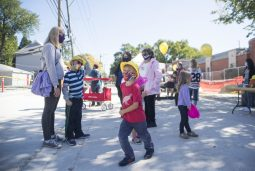 """Families hang out and view the construction site on Sept. 19, during the """"topping off"""" ceremony at the Brookfield Public Library. (Alex Rogals/Staff Photographer)"""