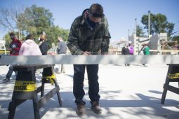 """Guests sign the beam on Sept. 19, during the """"topping off"""" ceremony at the Brookfield Public Library. (Alex Rogals/Staff Photographer)"""