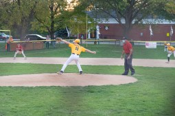 A LaGrange Park pitcher fires a pitch during the championship game of the Roy Overholt Tournament on Oct. 9. Due to COVID restrictions, umpires calling balls and strikes were positioned behind the pitcher. (Shanel Romain/Contributor)