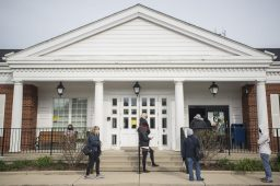 Voters are seen lined up outside on Oct. 19, during the first day of early voting at Brookfield Village Hall in Brookfield. (Alex Rogals/Staff Photographer)