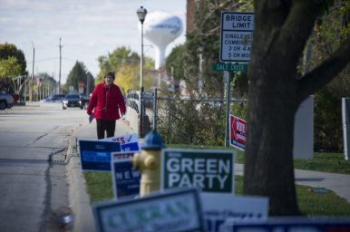 Campaign signs crowd the public parkways surrounding the early voting location at Brookfield Village Hall, where turnout is on pace to roughly double that seen during the last U.S. presidential election in 2016. (Alex Rogals/Staff Photographer)