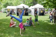 Sadie Brenneman, 8, does cartwheels and handstands.