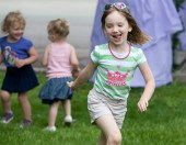 Clara Jordan, 5, runs around with friends while family listens to music.