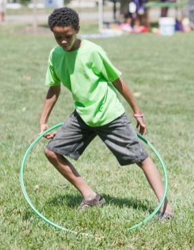 Alonzo Flowers, 11, tries to keep his hula hoop in rotation during the American Cancer Society Relay for Life of Brookfield-Riverside on Saturday, July 20. Alonzo, family and friends were on a team based out of Home Depot called Orange Life on a Mission.