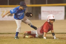 Brookfield's Alex Barrido slides into second and looks to see if the umpire called him safe. He didn't.