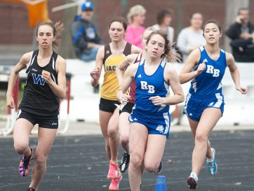 Riverside-Brookfield's Clare Bollnow, center, and Dee Dee Keen, right, compete in the girls 3,200-meter run at the 47th annual Gary Johnson Bulldog Relays. (David Pierini/staff photographer)