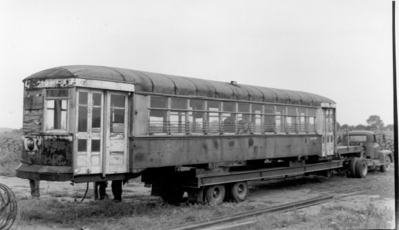 Car 141 begins its journey to the Electric Railway Historical Society, where it was kept under a tarp for many years before the restoration project began. (Photo courtesy of the Illinois Railway Museum Library)