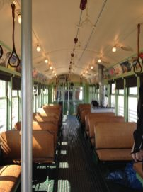 The interior of the streetcar was meticulously restored, down to the woven cane seats, coal stove, controls and fare register. The streetcar even sports retro advertising cards. (Photo by Bob Uphues)