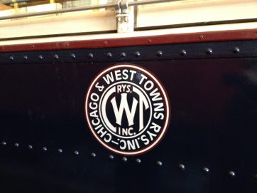 An authentic reproduction decal of the image (painted on back in the day) that would have appeared on the outside of the West Towns streetcar. (Photo by Bob Uphues)