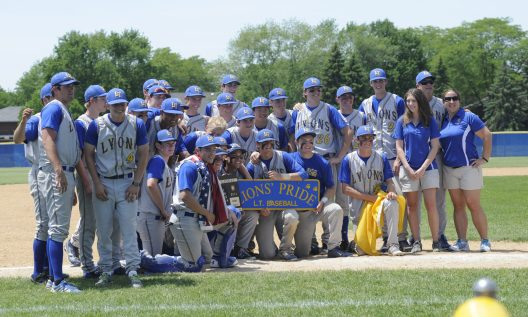 THe LTHS baseball team celebrates its regional title after an intense 5-3 win over conference rival Oak Park and River Forest. Since 2002, the Lions have won six state titles, two during the regular season and four in the summer state championship. (Photo by Jennifer Wolfe)