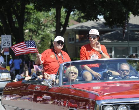 Emery Lehman (right) with grandfather Don Lehman rides in the 4th of July parade. Emery of Oak Park was one of the 2014 Olympic speed skaters.