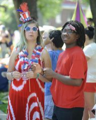 Emily Gately of Brookfield and Brandon Jackson of LaGrange Park watch the parade.