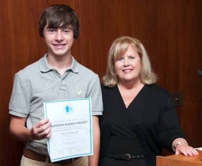 """In the photo (L-R): Jack Vomacka of St. Mary of Riverside School receives a certificate for his award-winning project, """"Water Wisely,"""" from MWRD President Kathleen Therese Meany."""