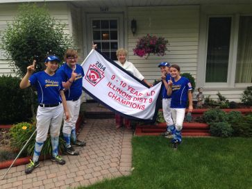 Several members of the Brookfield 10U team brought the District 9 flag over to share with Mrs. Overholt (Courtesy of Brian Conroy)