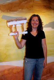 "Kim Piotrowski with a giant paintbrush she fabricated to paint ""Tide Tango"""
