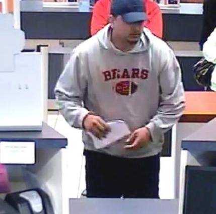 The FBI released this screen capture of bank surveillance video purporting to show Rodrigo Medellin during the commission of one of more than a dozen bank robberies he's suspected of committing. (Courtesy BanditTrackerChicago.com)