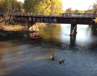 BOB UPHUES/Editor Recovery teams in the water and on boats combed the Des Plaines River last week after a woman was seen throwing bags into the water from the Cermak Road bridge. After a 2-hour search, they wound up finding a doll in a grocery bag.