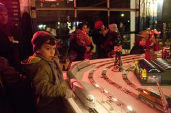 William Schueller , 5, watches the model trains pass by at set up at the Riverside Garage for the annual holiday stroll Friday. (David Pierini/staff photographer)