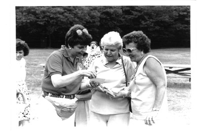 Voters loved Topinka for her down-to-earth attitude and her ability to connect with them. Here in an undated photo, she looks at photos with constituents at a picnic.