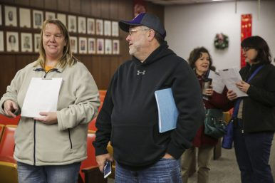 (From left) Candidates Carla Close Prosen and Michael Towner, both of the United Residents party, wait to file their paperwork to run for village trustee at the Brookfield Village Hall on Monday, December 15, 2014. | Chandler West/Staff Photographer
