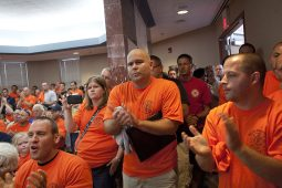 North Riverside firefighters and colleagues from nearby departments packed the council chambers during a village board meeting on July 14 to protest the plan to privatize the department. (File 2014)