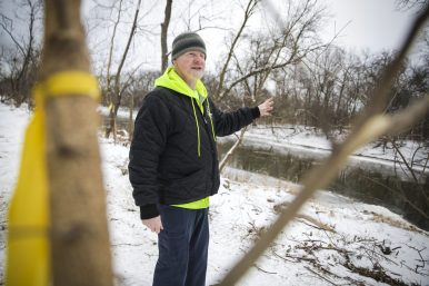 Opening views: Michael Collins, the Riverside village forester, points to new vistas of the Des Plaines River created with the removal of more than 100 trees, most of them ash trees, along the riverfront near Indian Gardens. (Chandler West/Staff Photographer)