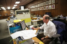 Finance Director Doug Cooper at his desk inside their makeshift office inside the Edward J. Barcal court room of the Brookfield Village Hall on Friday, January 9, 2015. The court room is acting as a makeshift office as the rest of the village hall is renovated. | Chandler West/Staff Photographer