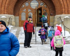 Central School Principal Peter Gatz directs students into the building on Jan. 8, when temperatures fell well below zero. The district had closed schools the day earlier, when morning temps were not as cold. | Jennifer Wolfe/contributor