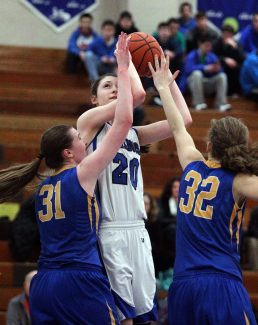 The Bulldogs' Dana Rettke readies for a shot against LTHS defenders Emily Pender (#31) and Erin Corrigan (#32). (Photo by Kevin Tanaka)