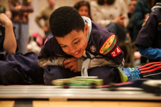 Isaiah Barnes, 8, gets a close look at the speeding cars in Pack 24 Cub Scouts' annual pinewood derby at Riverside Presbyterian Church on Saturday 24, 2015.   CHANDLER WEST/Staff Photographer