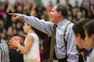 RBHS head coach Tom McCloskey shouts instructions to his players during the Bulldogs' 66-61 win over host Morton in a sectional final of the Class 4A playoffs. (Chandler West/Staff Photographer)