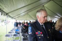 Riverside Police Chief Tom Weitzel during a moment of silence after giving the keynote speech at the 14th Annual Memorial Ceremony honoring peace officers killed in the line of duty. The Ceremony took place at the proposed site of a Cook County Peace Officers Memorial in Lyons, IL on Saturday May 9, 2015. | William Camargo/Staff Photographer