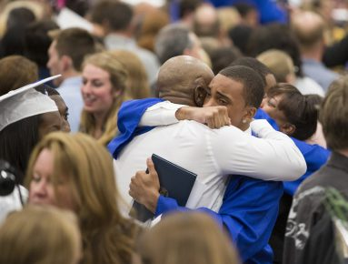 A member of the 2015 senior class embraces a family member at the finish of the commencement ceremony at Riverside-Brookfield High School on May 22.   Ting Shen/Contributor