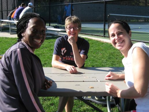 Gladiator Tennis players, left to right, Ngozi Ezike, Beth Gay and Catherine O'Rourke share a laugh during one of the many tournaments the league holds each summer. (Courtesy Steve Hess)