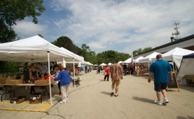 People enter the Brookfield farmers market on Saturday, June 13, 2015. |Photo by Jennifer T. Lacey