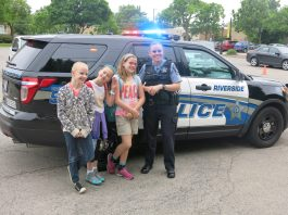 From left, Isabella Brunke, Callie Federow, Ella Kallenborn and Officer Tammy Pruim.