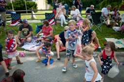 Children awaiting the start of the 4th of July parade in Brookfield on July 4, 2015. Weather was enjoyable and candy was thrown out to children who attended the parade.