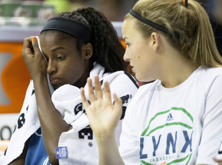 Minnesota forward Devereaux Peters, left, and guard Tricia Liston, teammates on Fenwick's 2007 state championship team, talk on the bench during the Lynx 90-83 loss to the Chicago Sky at Allstate Arena on July 10. (Ting Shen/Contributing Reporter)