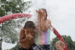 Children gather under the falling buckets of water to cool off Saturday, July 11 at Ehlert Park. Children took advantage of a much needed warm weekend at Ehlert Park.