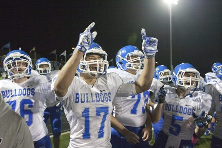 David Pribyl-Pierdinock, center, tore the anterior cruciate ligament in his right knee during an opening round playoff game against Glenbard South. The Bulldogs' senior linebacker/running back returns this fall to lead the team. (File photo)