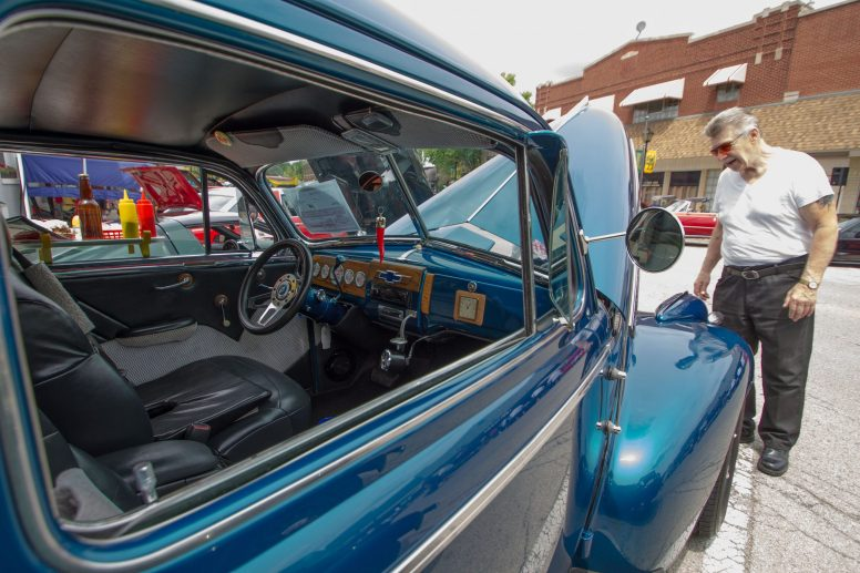 An attendee looks at the engine of 1940 Chevy two-door sedan during the annual Brookfield Chamber of Commerce Car and Bike Show on Sunday, July 19.   Jennifer T. Lacey/Contributor