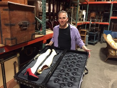 SPARES: Stephen Kolack displays a prop from The Goodman's 2001 production of The Visit, starring Chita Rivera, whose character called for hauling around a case containing two false legs. | Bob Uphues/Staff
