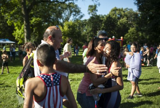 Paulina Arellano's parents congratulate her after finishing her race. | William Camargo/Staff Photographer