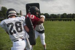 Fenwick senior fullback Gavin Graves breaks through some blocking pads during summer workouts. (William Camargo/Staff Photographer)